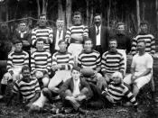 English: Rugby League team from Kandanga, ca. 1919 Kandanga is a small town in the Mary Valley, near Gympie. Early industries in the area include timber felling and sawmilling. Men who played in the football team could have worked in the timber industry.