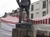 Statue of A E Housman - Bromsgrove High Street - looking at markets