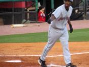Rashad Eldridge of the Oklahoma Redhawks walks to first base after drawing a base on balls.