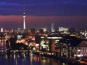 English: Berlin at night. Seen from the Allianz building in Treptow, showing the Universal building on the right at the river Spree and the TV-Tower at Alexanderplatz