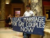 English: This protester was on his own and letting Minnesota state Senators know his position on gay marriage. This is freedom of speech in action.