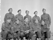 Chinese-Canadian soldiers from Vancouver, British Columbia, Canada, who served with the South East Asia Command (SEAC), awaiting repatriation to Canada, No.1 Repatriation Depot (Canadian Army Miscellaneous Units), Tweedsmuir Camp, Thursley, England, 27 No