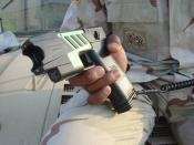 Advanced M26 TASER Stun Pistol - The United States military version of commercial TASERs for non-lethal detainment.