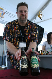 English: Fred Gilbert, an Ararat Import Export Co. sales representative, shows off bottles of Kalnapilis beer from Lithuania at the 13th Annual World Beer Festival held at the Durham Bulls Athletic Park in Durham, North Carolina.