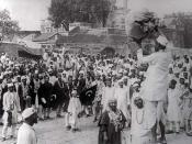 Hindus and Muslims, displaying flags of the Indian National Congress and the Muslim League, collecting clothes to be burnt as a part of the Non-cooperation movement, 1922.