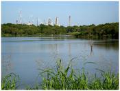 English: Goose Creek Stream in Baytown Texas with Exxon Mobil on the horizon.