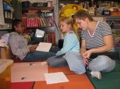 English: Patrick Henry Elementary School student teacher Isabell Pfeufer listens carefully as students edit their book reports Oct. 2. Pfeufer, who has been blind since birth, completed a three-week practicum with the class in Heidelberg, Germany, in Sept