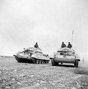 IWM caption : THE BRITISH ARMY IN NORTH AFRICA 1941. Crusader tanks moving to forward positions in the Western Desert.