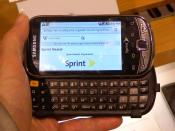 English: Samsung Intercept open in my hand and showing Wikipedia page about Sprint Nextel.
