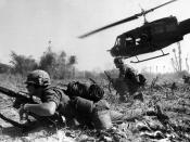 English: Major Crandall's UH-1D helicopter climbs skyward after discharging a load of infantrymen on a search and destroy mission.