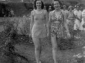 English: Swimsuit fashion parade at Government House, Brisbane, December 1940 Two models in fashionable swimwear in the gardens at Government House at the annual Red Cross Fete.