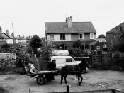English: Rag and bone man, Forge Road, Great Sankey Forge Road is an unmade cul-de-sac off Station Road in Great Sankey. The old forge, the roof of which can be seen on the extreme right, was used as a workshop for many years until converted to a bungalow