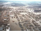 Red River of the North Main Stem, Grand Forks, North Dakota, looking toward Downtown area. Taken from a helicopter during the 1997 Red River Flood, after a levee overtopped and Grand Forks was evacuated.
