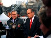 Secretary of Defense Donald Rumsfeld (left) and New York Mayor Rudy Giuliani (right) hold a joint media availability at the site of the World Trade Center disaster in lower Manhattan, on Nov. 14, 2001. Rumsfeld is visiting the site of the Sept. 11th disas
