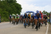 The peloton during the 2005 Tour de France. Clustering of the teams is apparent.