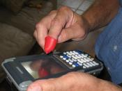 English: Accu-Text TM and a hand held inventory management devices (Touch Screen & Button Keypad)