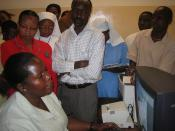 Members of Tanzania's Health and ICT network see a health management information system in action