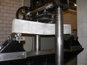 A testing machine measuring the tensile strength of a concrete beam