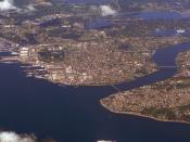 Sinclair Inlet and Puget Sound Naval Shipyard (left), Dyes Inlet (middle distance) and Manette and Warren Avenue Bridges (left to right) across Port Washington Narrows