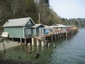 English: Some of the many beach cottages built on piers over Puget Sound in Fragaria Washington in Kitsap County along Colvos Passage.