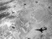 English: The shadow of a U.S. Air Force McDonnell RF-101C Voodoo is caught on a photo of a North Vietnamese flak site, circa 1965/67.