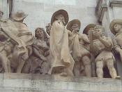 English: Rinconete and Cortadillo. Stone sculptural group made by Federico Coullaut-Valera Mendigutia (1912–1989). Added in 1960 to the monument to Cervantes (1925–30, 1956–57) at the Plaza de España (