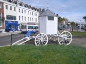 English: White cart near King George III statue