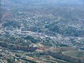 Aerial photograph of Nogales, Ariz. (lower left), the United States-Mexican border (diagonally from left to right), and Nogales, Sonora, Mexico (upper right).