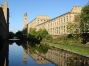 English: Titus Salt's mill in Saltaire, Bradford is an UNESCO World Heritage Site. Leeds to Liverpool Canal, Saltaire. Mill buildings built by Sir Titus Salt. Saltaire mills from the Leeds and Liverpool Canal. Salts Mill (left) and the New Mill (right) fr