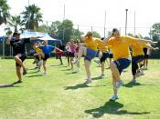 English: SAN DIEGO (Sept. 3, 2009) Fred Fusilier, lead personal trainer at Naval Medical Center San Diego, leads a fitness aerobics class during the Health and Wellness Department Fitness Expo. The event featured health and wellness educational booths and