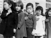 First-graders, some of Japanese ancestry, at the Weill public school, San Francisco, Calif., pledging allegiance to the United States flag. The evacuees of Japanese ancestry will be housed in War relocation authority centers for the duration of the war SU