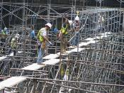 Contractors work to disassemble scaffolding at Fort Belvoir
