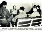 A neuropsychiatric social work technician conducts a group therapy session, with U.S. disciplinary barracks prisoners