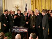 United States President George W. Bush shakes hands with U.S. Senator Arlen Specter after signing H.R. 3199, the USA PATRIOT Improvement and Reauthorization Act of 2005 in the East Room of the White House