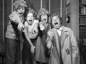 Harpo Marx and three of his children wearing Harpo wigs in Los Angeles, 1954