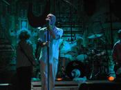 United States rock band R.E.M., in concert in Padova. From left to right; bassist Mike Mills, vocalist Michael Stipe, drummer Bill Rieflin, guitarist Peter Buck (half out of frame).