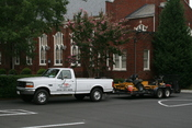 English: DJS Lawn & Landscape Ford F-250 XL pickup truck with lawn care equipment (riding mowers) on a trailer bed parked at Trinity Presbyterian Church in Durham, North Carolina.