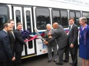 Congressman Honda lends San Jose Councilmember Forest Williams a hand at the ribbon cutting ceremony for the Zero-Emission Hydrogen Fuel Cell Bus Program.