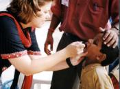 A child receives oral polio vaccine during a 2002 campaign to immunize children in India.