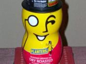A container of Planters Dry Roasted Peanuts