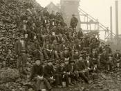 Upper Peninsula Michigan, USA, 1905. Miners pose with lunch pails in hand on a pile of
