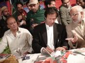 English: Picture of imran khan giving autographs at membership camp of Pakistan Tehreek-e-Insaf. It has been taken by the Administration of www.insaf.pk, who have allowed to use it.