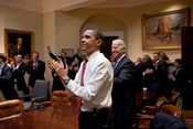 English: President Barack Obama, Vice President Joe Biden, and senior staff, react in the Roosevelt Room of the White House, as the House passes the health care reform bill.