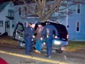 English: Police in Connecticut administer the one leg stand test to a driver after a crash. Photo was run through a paint daub filter to blur identifiable features of individuals