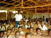 Teacher with students in Benin classroom