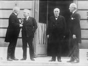 English: Photograph of the Big Four at the Paris peace conference after World War I on May 27, 1919. From left to right: British Prime Minister David Lloyd George, Italian Premier Vittorio Orlando, French Premier Georges Clemenceau and President of the Un
