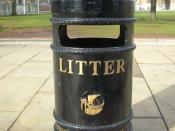 A litter bin located on College Green, Bristol, UK with the logo of Bristol City Council visible.