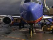 A Southwest Airlines Boeing 737 aircraft parked on the tarmac under cloudy skies at Bob Hope Airport in Burbank, California, United States.