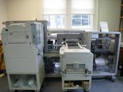 An on-demand book printer at the Internet Archive headquarters in San Francisco, California. Two large printers print the pages (left) and the cover (right) and feed them into the rest of the machine for collating and binding. Depending on the number of p