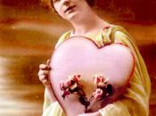 Early 20th century Valentine's Day card, showing woman holding heart shaped decoration and flowers, scanned from period card from ca. 1910 with no notice of copyright.